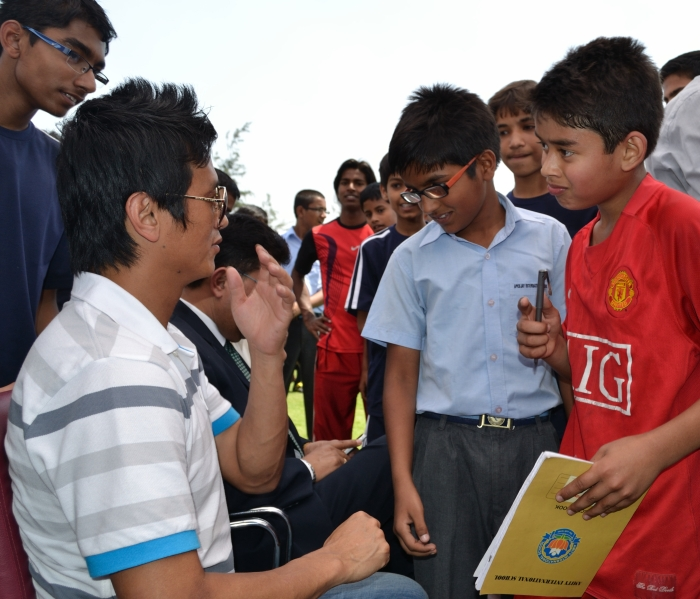 Boys greet Indian football legend Bhaichung Bhutia at his academy in Delhi. Photographed by Monica Sarkar