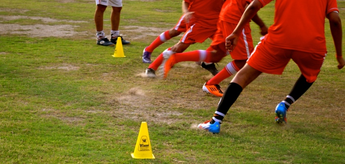 Boys practice at the Steve McMahon Football Academy, Delhi.