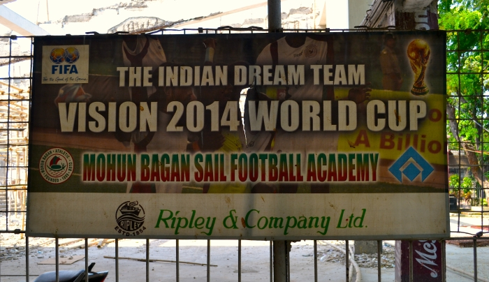 A tattered poster depicting India's football dreams hangs on a fence at Mohun Bagan F.C.'s club grounds in Kolkata. Photographed by Monica Sarkar