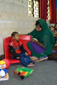 Manish Singh, 7, who suffers from cerebral palsy, sits supported with an aid.