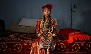 Nepal's current living goddess of Patan city, Samita Bajracharya, sits in her bedroom prior to her daily rituals. Photograph: Narendra Shrestha/EPA